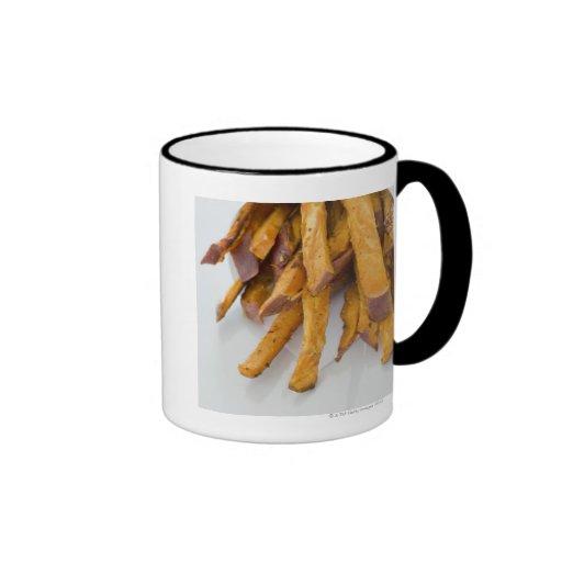 Sweet Potato fries in paper bag, close up, Mug