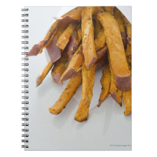 Sweet Potato fries in paper bag, close up, Notebook
