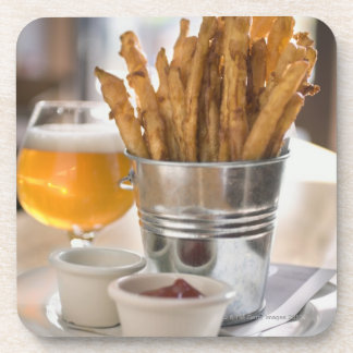 Sweet potato fries served with vinegar and beverage coaster