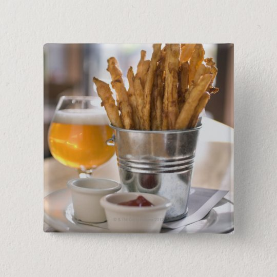Sweet potato fries served with vinegar and button