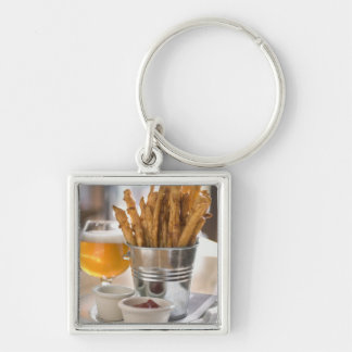 Sweet potato fries served with vinegar and keychain