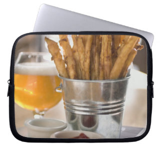 Sweet potato fries served with vinegar and computer sleeves