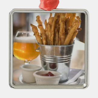 Sweet potato fries served with vinegar and metal ornament