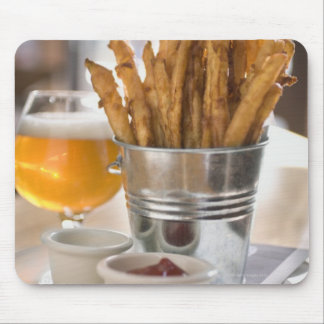 Sweet potato fries served with vinegar and mouse pad