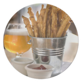 Sweet potato fries served with vinegar and dinner plates