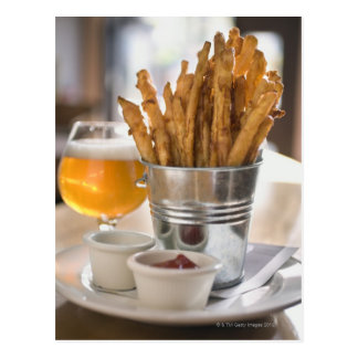 Sweet potato fries served with vinegar and postcard