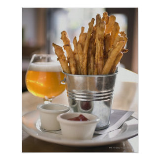 Sweet potato fries served with vinegar and poster