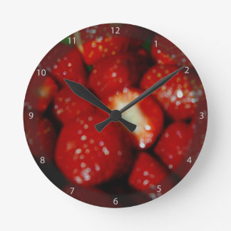 Sweet strawberries in the grocery round clock