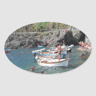 Swimmers at Cinque Terre Oval Sticker
