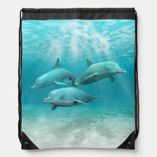 Swimming Dolphins Drawstring Backpacks