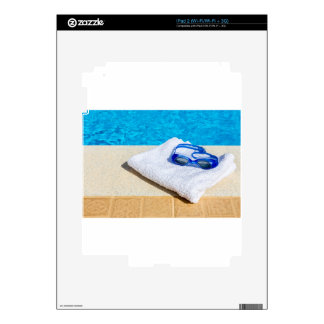 Swimming goggles and towel near swimming pool decals for the iPad 2