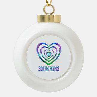 Swimming Hearts Ceramic Ball Christmas Ornament