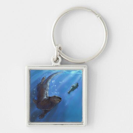 Swimming otter keychain