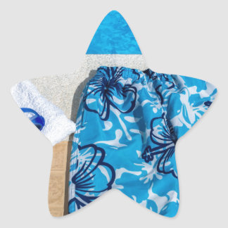 Swimming trunks goggles and towel at pool star sticker