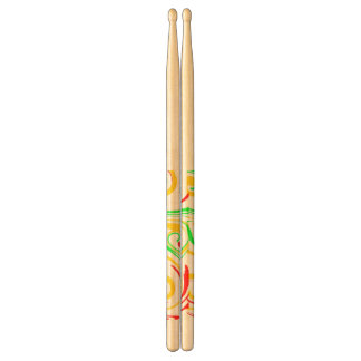 Swirling abstract yellow red green, on drum sticks