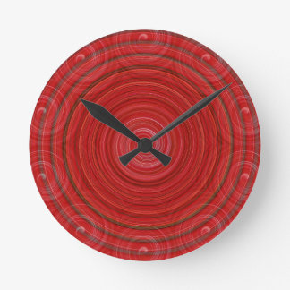 swirls of red round clock