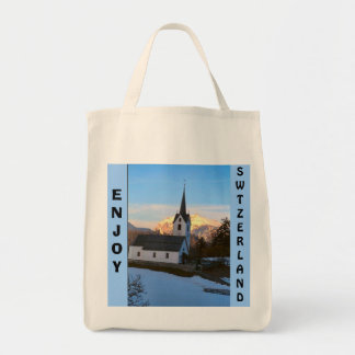 Swiss church in the mountains tote bag