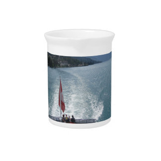 Swiss flag on a cruise ship on Lake Thun Drink Pitcher