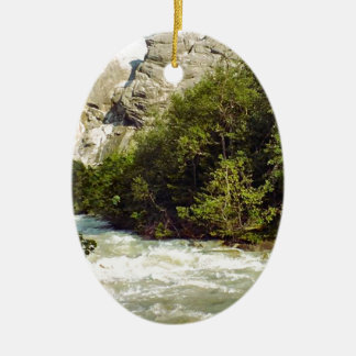 Swiss glacier and meltwater river Double-Sided oval ceramic christmas ornament