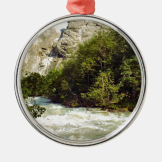 Swiss glacier and meltwater river round metal christmas ornament