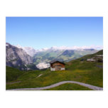 Swiss house and alps postcard
