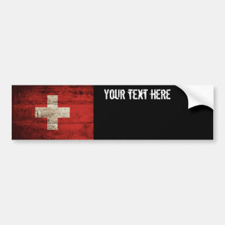 Switzerland Flag on Old Wood Grain Bumper Sticker