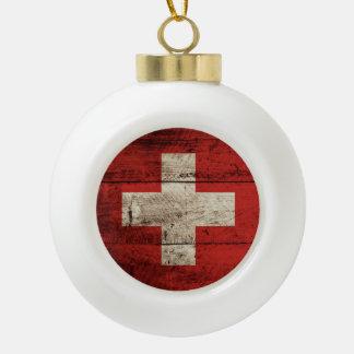 Switzerland Flag on Old Wood Grain Ceramic Ball Christmas Ornament