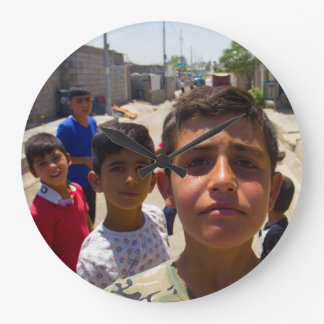 Syrian refugee boys in Erbil, Iraqi-Kurdistan Large Clock