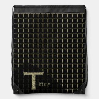 T - El alfabeto de Falck (de oro) Mochilas