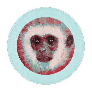 Tabla de cortar (roja) de la cara del mono