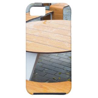 Tablas al aire libre redondas mojadas del café en iPhone 5 carcasa
