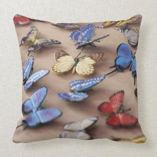 Table full of butterflies throw pillow
