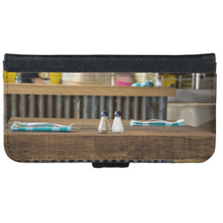 Table in a diner with salt and pepper shakers iPhone 6 wallet case