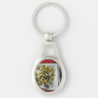 Table settings at time of a meal Silver-Colored oval metal keychain