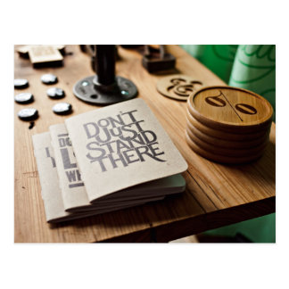 Table with books and coasters postcard