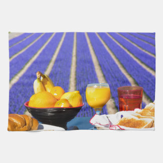 Table with food and drink near flowers field kitchen towel