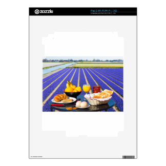 Table with food and drink near flowers field skins for the iPad 2