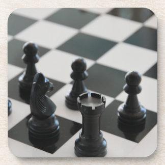 Tablero de ajedrez y prácticos de costa de los ped posavaso