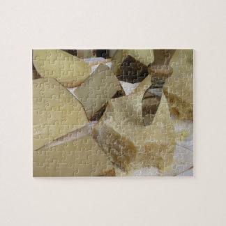 Tablero del queso con parmesano puzzle