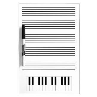 Tablero seco del borrado del piano y del personal pizarra