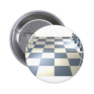 Tablero y pedazos de ajedrez pins