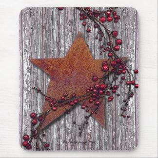 Tableros del granero con la estrella aherrumbrada mousepads