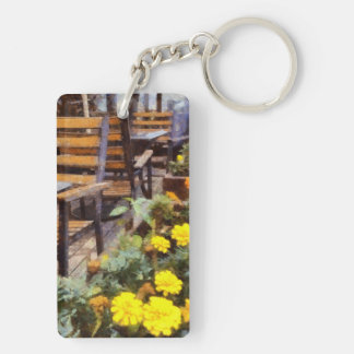 Tables and chairs with flowers keychain