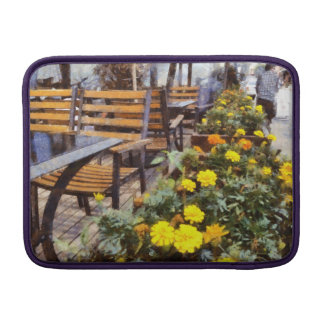 Tables and chairs with flowers MacBook air sleeve