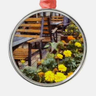 Tables and chairs with flowers metal ornament