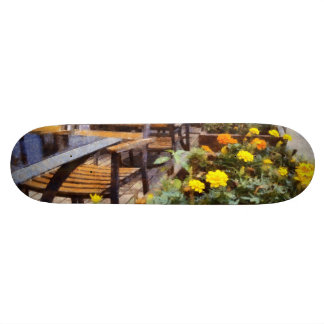 Tables and chairs with flowers skateboard