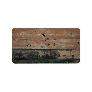 Tablones de madera con la fotografía creciente de etiqueta de dirección