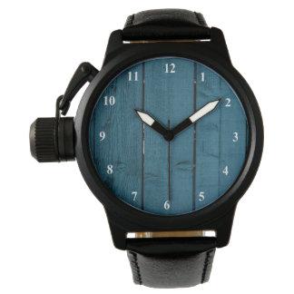 Tablones de madera pintados azul relojes