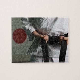 Taekwondo Fighter Tightening Belt Jigsaw Puzzle