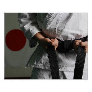 Taekwondo Fighter Tightening Belt Poster